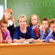 Pupils and teacher — Stock Photo