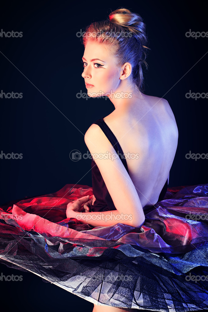 Beautiful ballet dancer posing at studio.  Stockfoto #11686441
