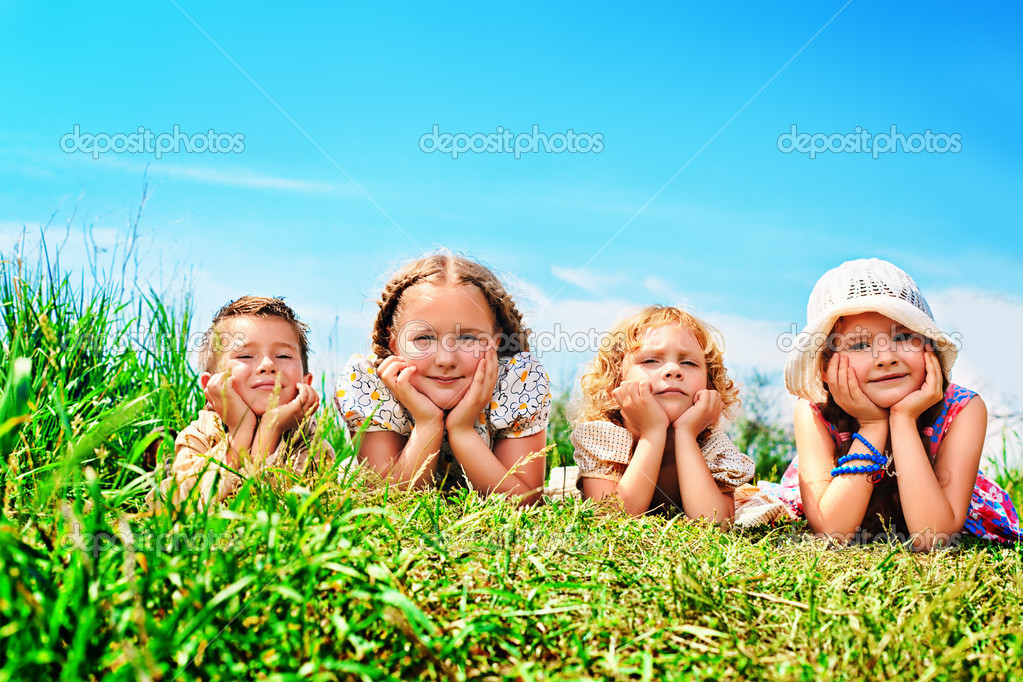 Group of happy children having a rest together outdoors.  Stock Photo #11686451