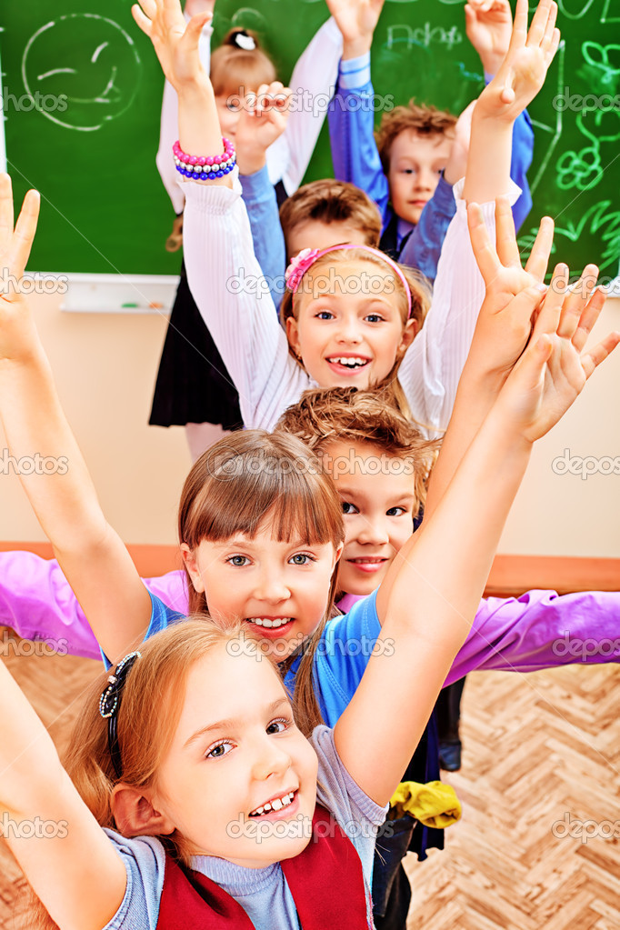 Happy schoolchildren at a classroom. Education. — Stock Photo #11851289