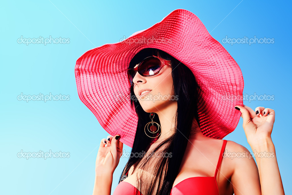 Beautiful young woman in bikini over blue sky. — Stock Photo #11851475