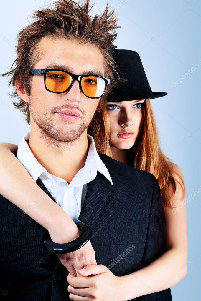 Shot of a fashionable couple posing at studio.  Stock Photo #11869607