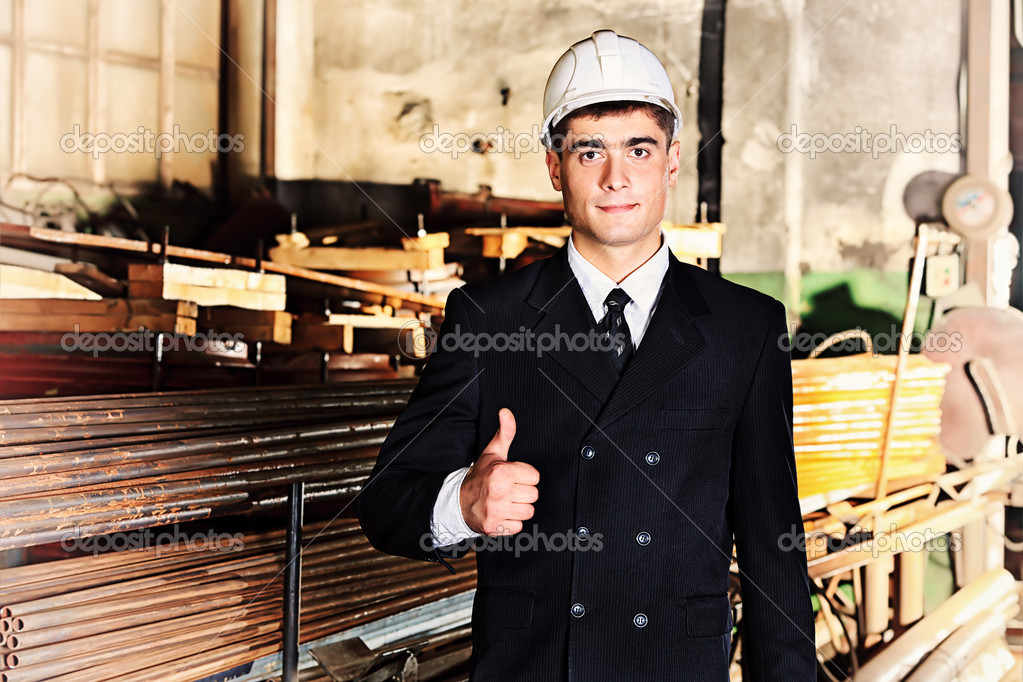 Industrial theme: businessman at a manufacturing area. — Stock Photo #11935974