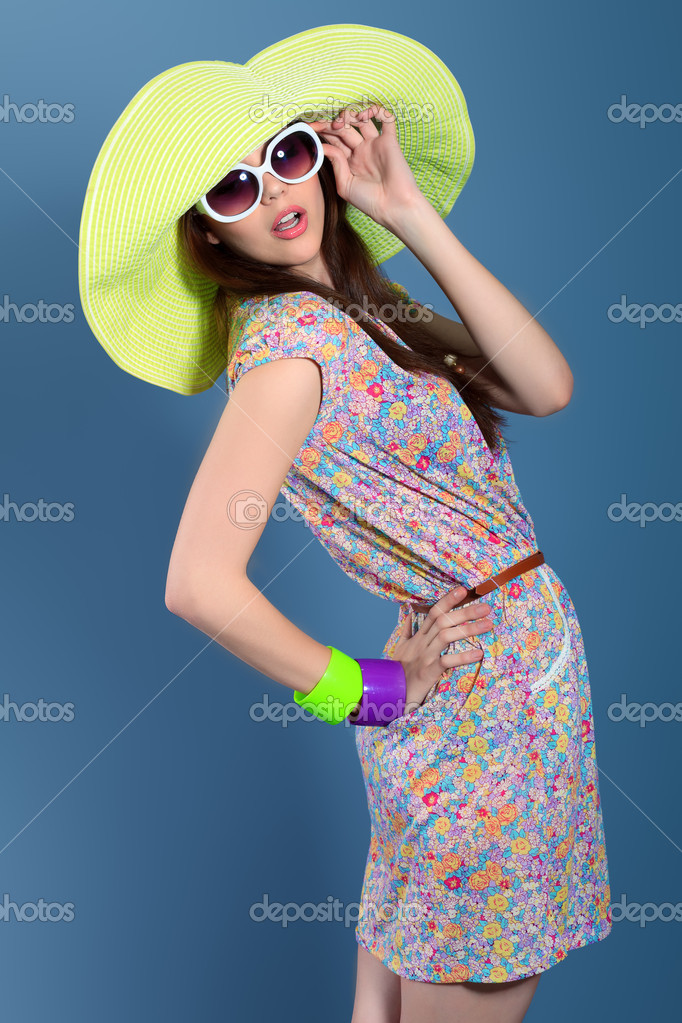 Shot of a beautiful girl in summer style posing at studio.  Stock Photo #11947508