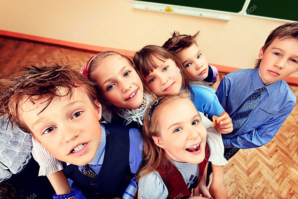 Happy schoolchildren at a classroom. Education.  Stock Photo #11947527