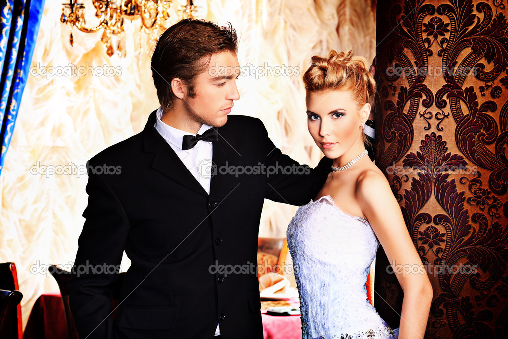 Charming bride and groom on their wedding celebration in a luxurious restaurant. — Stock Photo #11972936