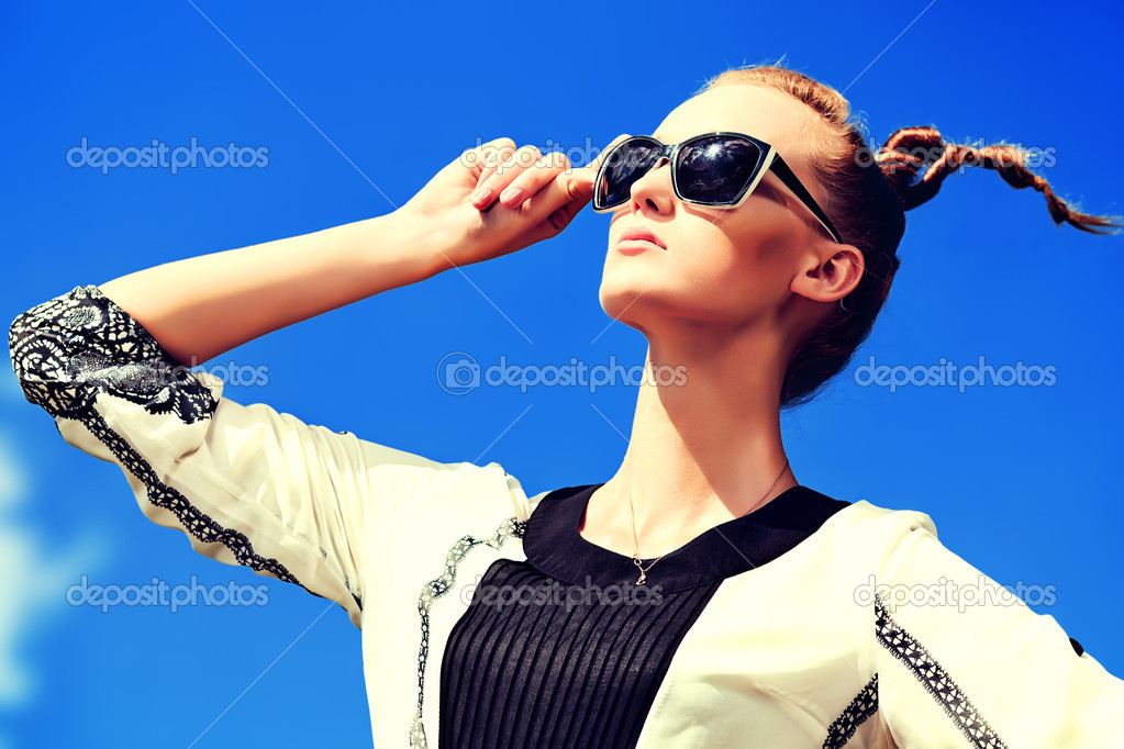 Fashion woman posing over blue sky.  Stock Photo #12003339