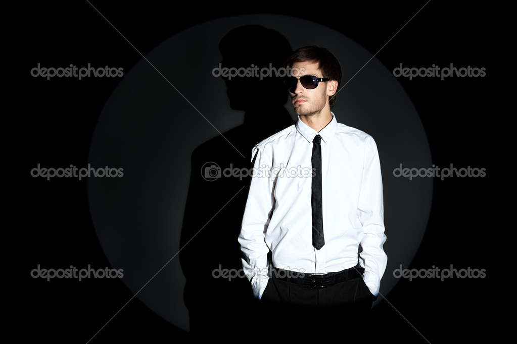 Portrait of a handsome man over black background. — Stock Photo #12157125