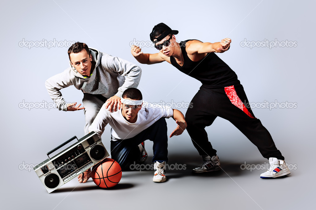 Group of trendy teenagers dancing hip-hop at studio. — Stock Photo #12157136