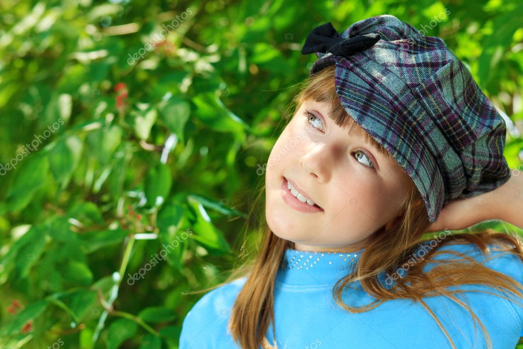 Portrait of a cute smiling girl outdoor.  Stock Photo #12157157
