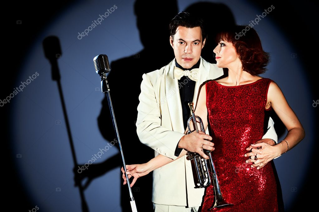 Portrait of a musician playing the trumpet. Black background. — Stock Photo #12196438
