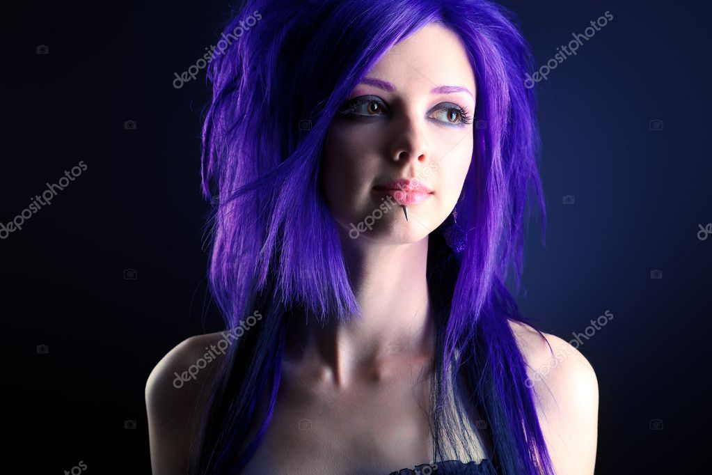 Portrait of a punk girl. Over black background. — Stock Photo #12338713
