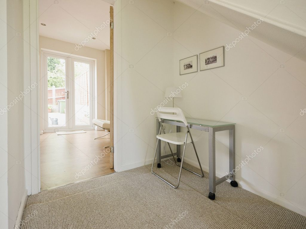 A home office space under stairs in a converted house — Stock Photo #10812922