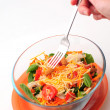Eating a healthy bowl of salad with a fork — Stock Photo