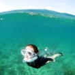 Young woman snorkeling underwater — Stock Photo