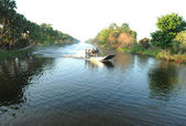Airboat on river — Stock Photo