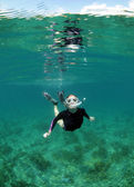 Young woman snorkeling — Stock Photo