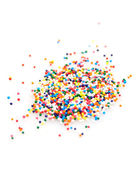 Colorful sprinkles on white background — Stock Photo