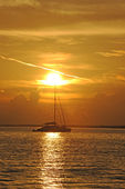 Sailboat in ocean with sunset — Foto Stock