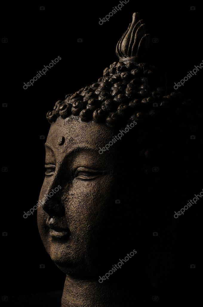 Buddha head on a black background — Stock Photo #10771312