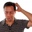 Man Scratching head in confusion — Stock Photo