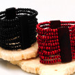 Stock Photo: Red and black beaded bracelets