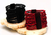 Red and black beaded bracelets — Stock Photo