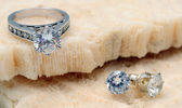Diamond engagement ring and diamond earrings — Stock Photo