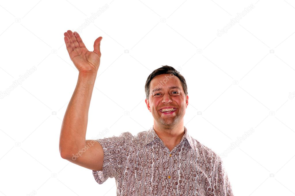 Friendly young man waving hello or goodbye while smiling — Stock Photo #10909087