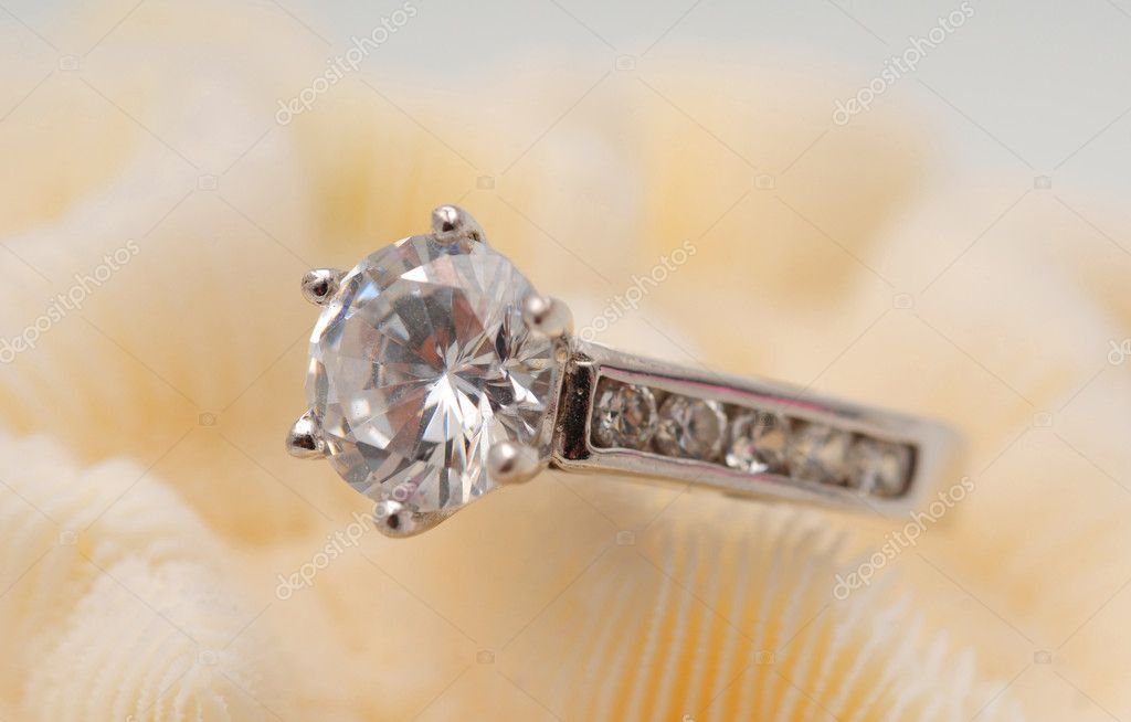Large round solitaire diamond on an engagement ring — Stock Photo #10909267