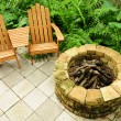 Adirondack chairs and fire pit - Stock Photo