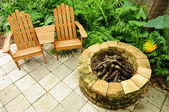 Adirondack chairs and fire pit — Stock Photo
