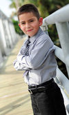 Young boy in suit with arms crossed — Stock Photo