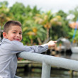 Stock Photo: Very happy child pointing at boats