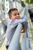Cute Boy handing out — Stock Photo