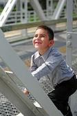 Happy child climbing — Stock Photo
