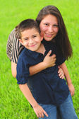 Beautiful mom hugging son — Stock Photo