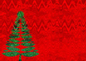 Beautiful green Christmas tree on red background — Stock Photo