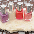 Four bottles of colorful nail polish — Stock Photo