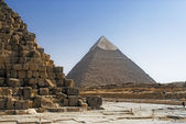 Part of the masonry of the pyramid of Cheops Pyramid of Khafre in the background. — Stock Photo