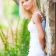 Young beautiful girl standing by the wall — Stock Photo