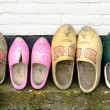 Wooden shoes against a wall — Stock Photo