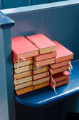 Bibles on a blue pew — Stock Photo