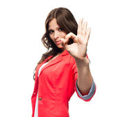 Young business woman doing Ok gesture. Focus on hand — Stock Photo