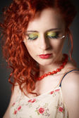 Fashion shot of an beautiful red hair gir — Stock Photo