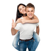 Happy young couple with his thump up — Stock Photo