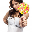 Pretty young woman with lollipop candy. Focus on hand — Stock Photo