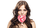 Pretty young woman with lollipop candy — Stock Photo