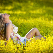 Young attractive girl outdoor in the field. Blonde girl — Φωτογραφία Αρχείου #10998536