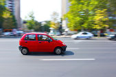 Small car running on the street — Stock Photo